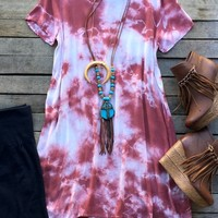 Our Help Me Hold On Tunic Dress is a must have! It's a short sleeve tunic dress with a tie dye effect. Scoop neckline with high/low style. Unlined. Made to be loose fitted.