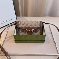 GUCCI Pair with gold buckle bag