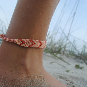 Orange/peach handmade string bracelet/anklet - arrow tribal pattern - will fit any width wrist or ankle