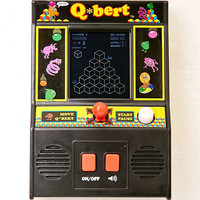 Classic Q*bert Hand Held Game | Urban Outfitters