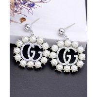 GUCCI new women's personality exaggerated inlaid zirconium G letter earrings silver
