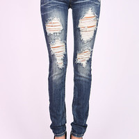Distressed Skinnies - Machine Jeans