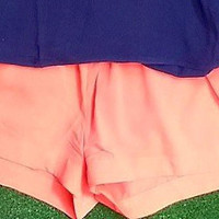 CRISS CROSS SHORTS IN CORAL