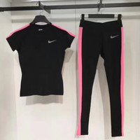 Nike:Women's speed dry short sleeved yoga, leisure and running training, short sleeved + trousers suit