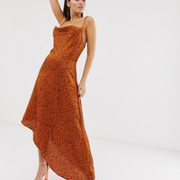 Missguided cowl neck slip dress with asymmetric hem in polka dot print | ASOS
