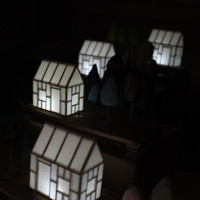 Miniature house light with subtle pastel trees on a antique Victorian wood base