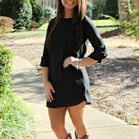 Black sheer dress with rolled button dress.
