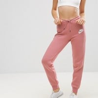Nike Rally Tight Fit Sweat Pants at asos.com