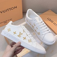 LV  Embroidered small white shoes with thick soles