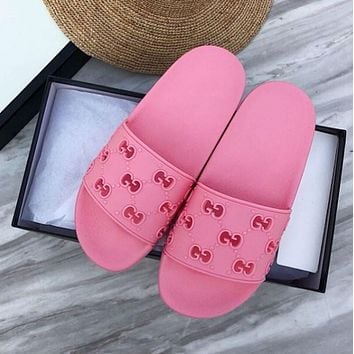 GUCCI Men Women's rubber GG slide sandal pink