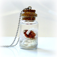 Ice Age inspired bottle necklace, winter wonderland scene with mammoth on a glacier