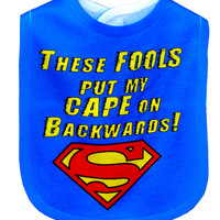 These Fools Put My Cape On Backwards Funny Baby Bib Superhero Infant Baby Shower Gift for new Parents