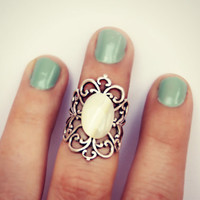 silver and pearl knuckle ring
