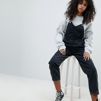 ASOS DESIGN denim overall with pleat detail in washed black at asos.com