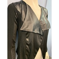 happening in the present shrug with faux leather