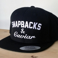 SnapBacks and Caviar Cap with Custom Embroidered Logo.  Made to order quality snap back hats and designs