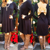 WRAPPED AND READY SEQUIN BOW TUNIC DRESS IN BLACK