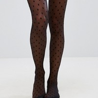 ASOS DESIGN medium polka dot tights at asos.com