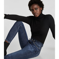 SKINNY JEANS WITH RUFFLE TRIMSDETAILS