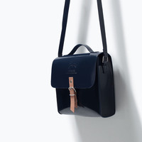 Buckled glossy handbag
