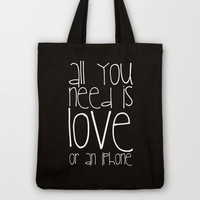 FUN QUOTE ... ALL YOU NEED IS LOVE OR AN IPHONE ... Tote bag / Society6 / Monika Strigel