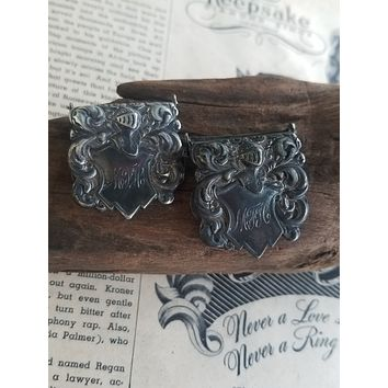 Antique heretic knight shielded silver plated monogram MFH pair of belt buckles