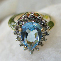 Gold Ring with Blue Topaz and Diamonds