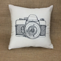 Pillow with embroidered camera