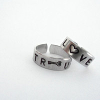 Trust and Love  Hand Stamped Aluminum Rings  A by timelessmaiden