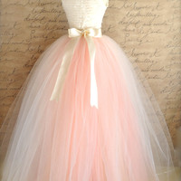 Full length blush tulle full length skirt. Ivory and antique pink tulle lined in ivory satin for women. Weddings and formal wear.