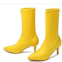 A new style of pointed suede boots with thin heels for women
