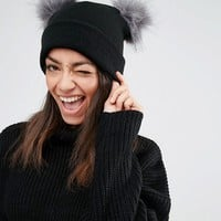 New Look Double Faux Fur Pom Pom Beanie Hat at asos.com