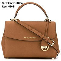 Michael Kros new Cambridge bag with crossed leather handbag shoulder bag Brown