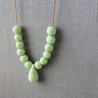 Handmade mint green ceramic beads - mint green strand necklace - beadwork on thin leather cord