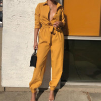 Spring and summer women's new button deep V season girdle jumpsuit