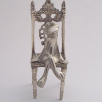 Vintage solid brass frog sitting on a throne from Suki and Polly