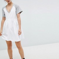 ASOS DESIGN mini smock dress with v neck and contrast sleeves at asos.com