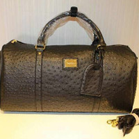 Black and gold ostrich duffle bag