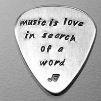 Aluminum Guitar Pick Handmade and Stamped with Music is Love in Search of a Word
