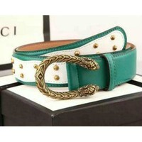 STUDDED LEATHER BELT WITH METAL BOW GUCCI BELT