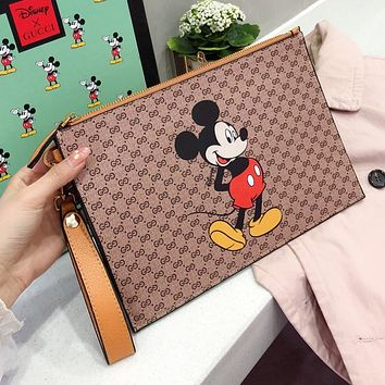 GUCCI x Disney Hot Sale Men Women Leather Handbag Tote Wash Gargle Bag Wrist Bag Wallet