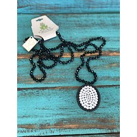 1N335BLCL Black large oval w/ clear crystals
