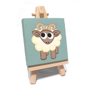Cute Ram mini painting - small acrylic artwork of cartoon white sheep with curly horns, miniature canvas with easel or ribbon hanging