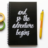 Writing journal, spiral notebook, bullet journal, black and white, sketchbook, blank lined or grid paper - And so the adventure begins