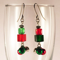 Jingle Bell christmas earrings .. Dangle earrings with Red, Green and Silver bells, glass cube beads and rhodium-plated ear wires