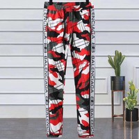 Balenciaga 2019 new personality wild men's red black striped casual pants