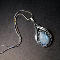 Rainbow moonstone pendant, wire wrapped, sterling silver
