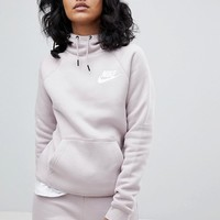 Nike Rally Pullover Hoodie In Pink at asos.com