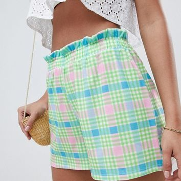 ASOS DESIGN culotte shorts with paperbag waist in check print at asos.com