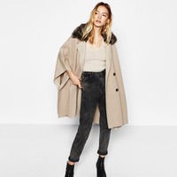 CROSSOVER CAPE WITH FAUX FUR COLLAR DETAILS